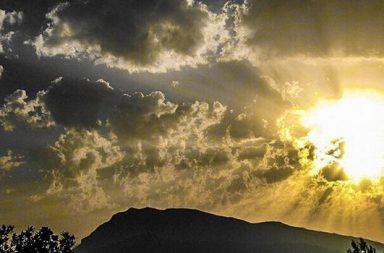 Sonne Berge Wolken